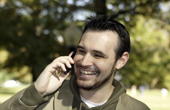 guy smiling and talking on the phone